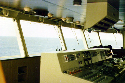 Bridge of MV President John F. Kennedy one of American President Lines' New C10 Containerships. I did 3 relief jobs on this type of ship. I was on the JFK, The President Polk and the President Adams. These ships had a crew of 21. When I began my career in the Merchant Marine in 1967 ships typically were manned by about 40 men.